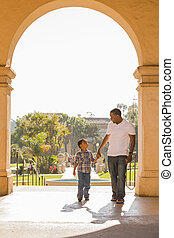 Mixed Race Father and Son Walking in the Park - Happy...