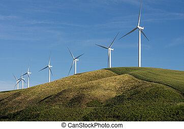 Row of wind turbines on hill