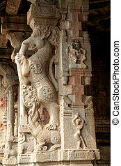 Stone Pillar Carving - Carved designs on stone pillar at...