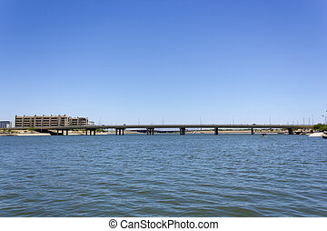 Tempe Lake, Phoenix, AZ - Rural road bridge over Tempe lake,...