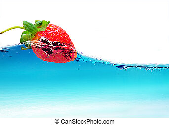 Strawberry falls deeply under water with a big splash.