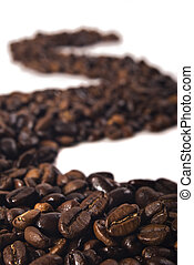 Row of coffee beans on white background
