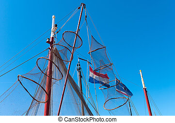 fishing nets hanging to dry - fykes for catching eel hanging...