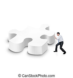 business man pusing a 3d puzzle over white background