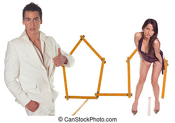 House - Young couple with model house of wooden metre