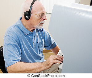 Senior Man Votes - Senior man using headphones and voting on...