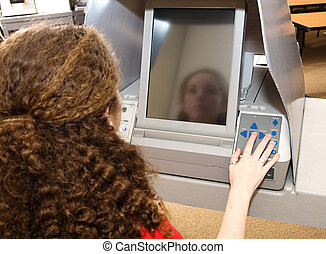 Teen Voting on Touch Screen - Eighteen year old girl voting...