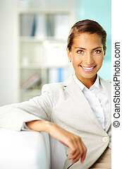 Positive woman - Smiling office worker looking at camera