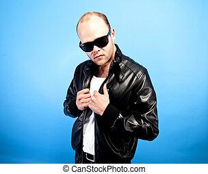 gangster - man in lether jacket on blue background