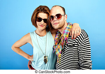 woman and man togheter with sunglasses on blue background