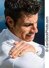 Shoulder Pain - Sportsman feels pain because of a shoulder...