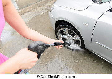 Washing car - Detail of woman cleaning car with water in...