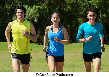 Runners Outdoors - Young runners training in a park.