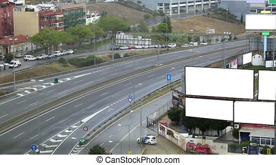 Billboards on a highway - City timelapse with empty...