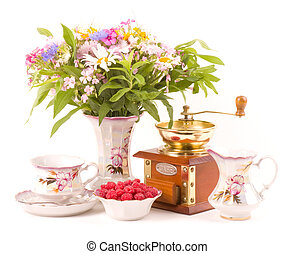 teacups, raspberry, coffee grinder and flowers