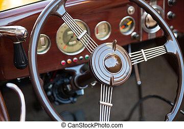 Vintage car - Closeup of vintage car steering wheel,...