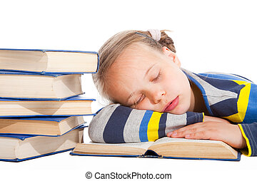 schoolgirl sleeping over the book on isolated white -...