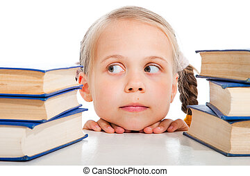 girl choosing the books on isolated white - Portrait of cute...