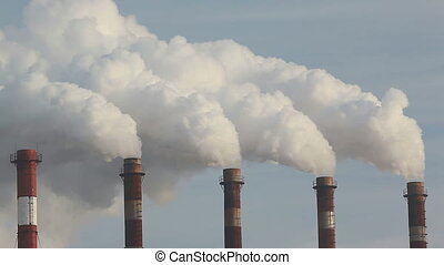 air pollution - five chimneys producing thick white smoke