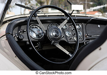 retro styled classic car dashboard under sunlight