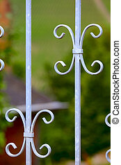 Grating - A metal grating in a garden door, small city...