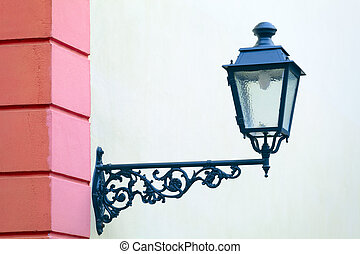 Street lamp - Old electric street lamp on house facade in...