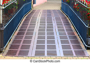Metal bridge - Small metal bridge on the promenade in city...