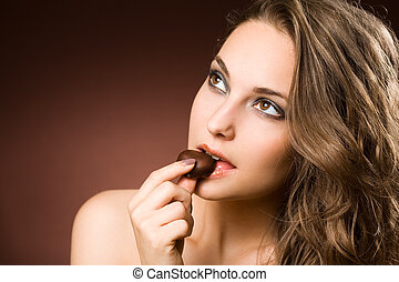 Chocolate loving brunette beauty - Portrait of a chocolate...