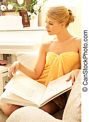 beautiful woman in spa salon with book