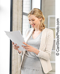 happy woman with documents - indoor picture of happy woman...