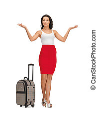 happy woman with suitcase greeting