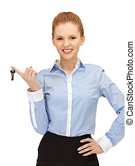 happy woman with keys - bright picture of happy woman with...