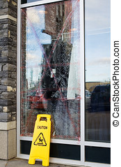 vandalism - A store window that was broken, and looks like a...