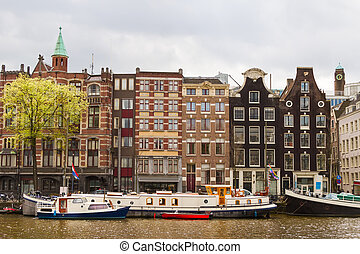 Street with traditional buildings in Amsterdam - Traditional...