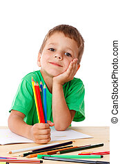 Little boy draw with crayons