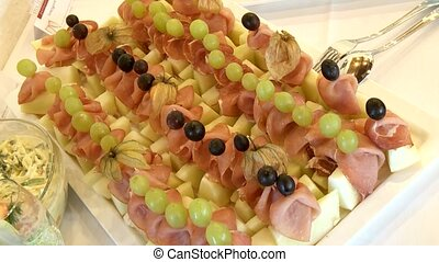 Buffet With melon and ham