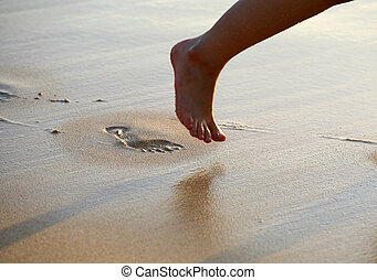 Foot Prints on Beach - Image of foot prints and legs on...