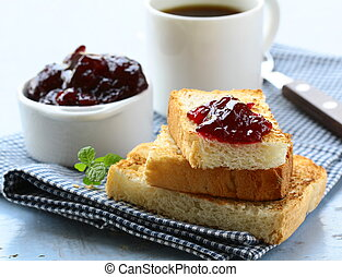 breakfast with toast and cherry jam