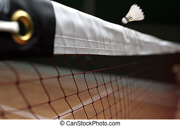 Photo of shuttle badminton net up close and a fast moving...