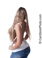 Sexy blonde woman in jeans and white tank top