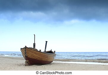 Fishing boat on the beach of the island of Usedom in bad...