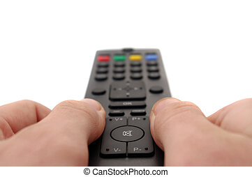 channel changing - hands and tv remote control
