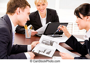 Planning - Image of business people planning a new project...