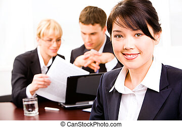 Smart professional - Image of pretty smiling businesswoman...