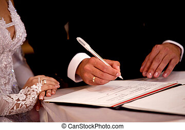 registration form - Couple signing marriage registration...
