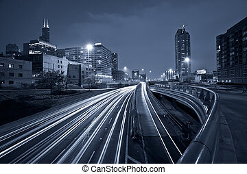Nighttime highway traffic. - Toned image of multi lane...