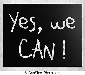 quot;Yes, we canquot; handwritten with white chalk on a...