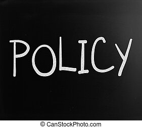 """The word """"Policy"""" handwritten with white chalk on a..."""