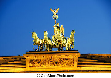 Majesty of Quadriga over Brandenburg Gate, with dramatic...