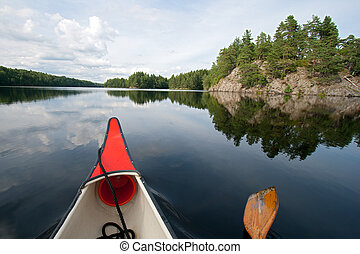 Canoeing - Canoe on a quiet lake in Sweden
